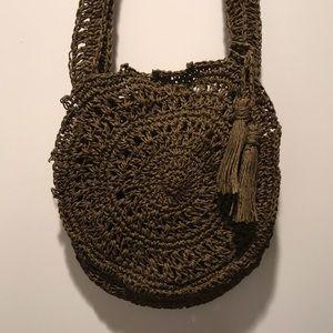 FP crocheted straw bag. Dark brown/olive tones.